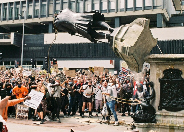 The moment that the statue of Edward Colston was pulled from its plinth (Picture: Harry Pugsley/SWNS)